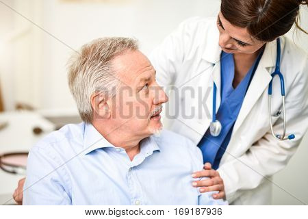 Doctor talking to a patient in wheelchair