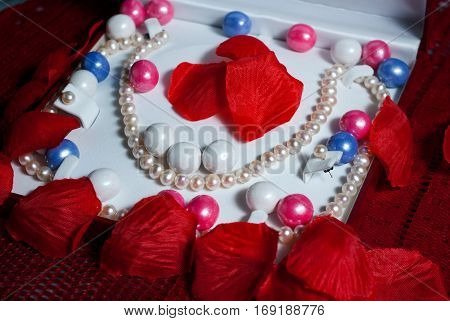 Pearls in a presentation case with petals and pearl gumballs