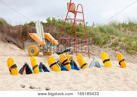 Empty lifesaver chair and equipment on the beach dunes