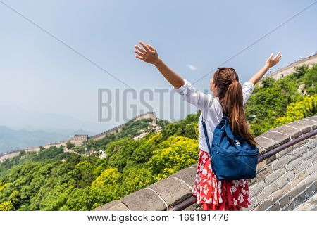 Freedom travel lifestyle woman student. Happy tourist backpacker at Great Wall of China having fun at famous Badaling ruins during travel holidays at Chinese destination. Asia vacation.