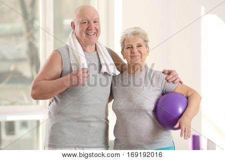Elderly patients in modern rehabilitation center poster