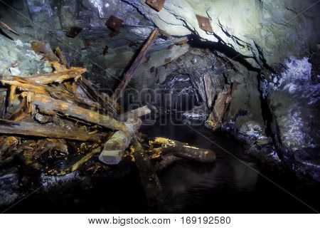 Collapsed and forgotten tunnel of an abandoned coal mine