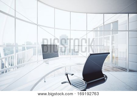 Modern office interior with blank computer screen on rounded table chair and panoramic window with city view. Mock up 3D Rendering