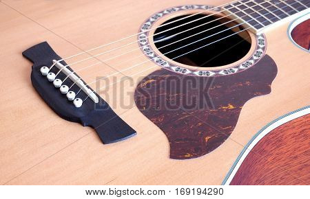 Classic acoustic six strings guitar natural color top from spruce satin finish with cutaway op view closeup