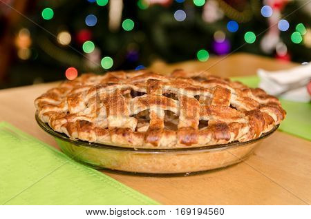 Freshly Baked Apple Pie with Lattice Top Crust on Table Top