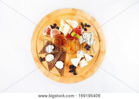 different sorts cheese fruits bread wooden plate
