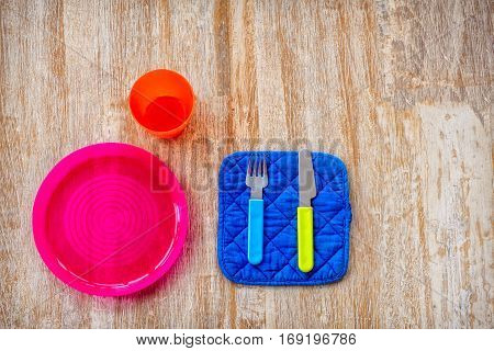 children silverware plastic cutlery wooden boards brown background