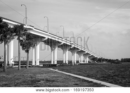 Jensen Beach Bridge Florida USA crossing Indian River on a cloudy and windy day black and white photography