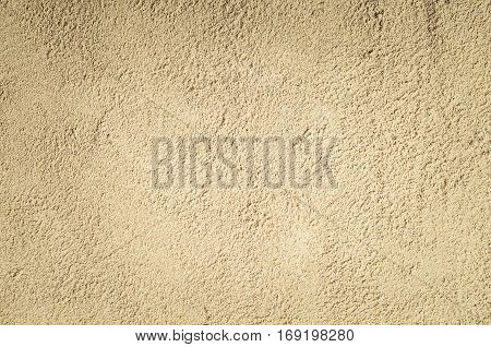 Top view of sandy beach. Background with copy space and visible sand texture.