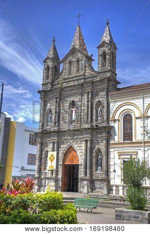 Old colonial church facade, on a sunny morning, blue sky, in Ibarra Ecuador.