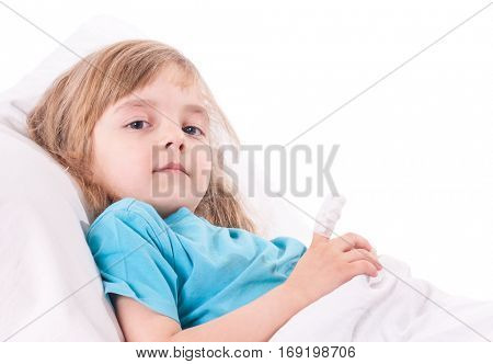 Little sad girl with a bandaged finger in bed. Portrait of illnes kid looking at camera, resting at home.
