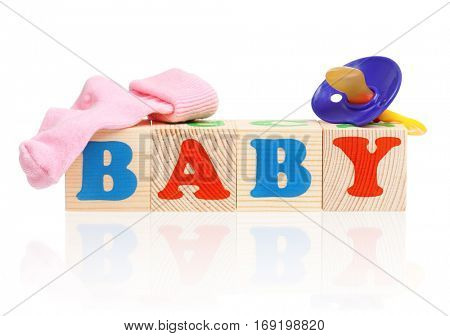 Baby word formed by colorful wooden alphabet blocks, isolated on white background