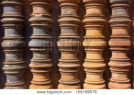 Cambodia a fragment of a wall historical the building or the temple with ancient columns closeup