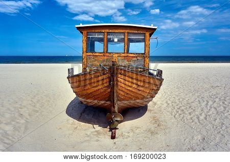Wooden fishing boat on a sandy beach on the island of Usedom Germany