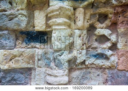 background and the abstract textured surface of an ancient stone wall