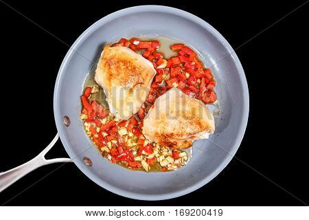 Chicken Thighs With Pepper And Garlic Are Fried In A Skillet. Insulated