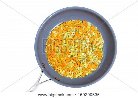 Chopped Onions And Carrots Fried In A Skillet. Insulated