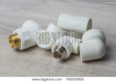 Connection for polypropylene pipes on a white background construction concept