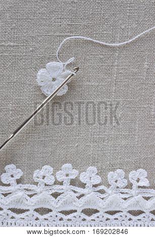 The beginning of handmade crocheted cotton organic doily flower. Old metal crocheting hook. Needlework creative craft Mori Girl lace style