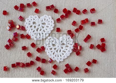 Two creative cotton Irish crochet lace white hearts and beads. Handmade knitted Easter Christmas Valentine day linen backdrop for wedding birthday celebration. Mori Girl lace craft bridal style