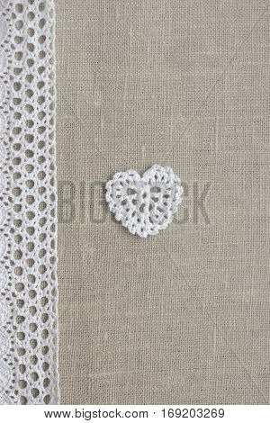 Linen creative cotton Irish crochet lace white heart. Handmade knitted Easter Christmas Valentine day backdrop for wedding birthday celebration. Mori Girl lace craft bridal style
