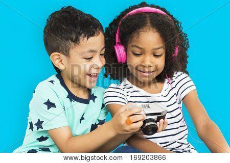 Little Boy Show Camera Little Girl Earphone