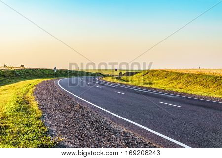 Countryside asphalt road with marking. Rotate the track. Belgorod region Russia.