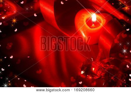 Valentine's Day background. Valentine Day frame design with red heart shaped candle, satin ribbon over red silk. Holiday Valentines gift greeting card backdrop.