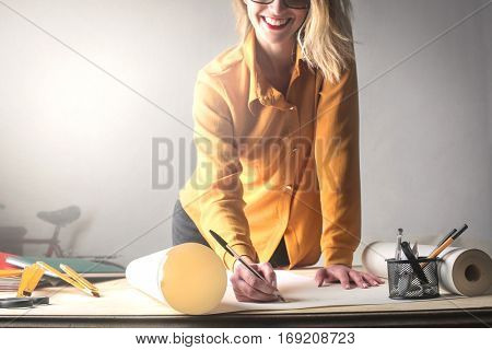Blonde architect drawing cheerfully