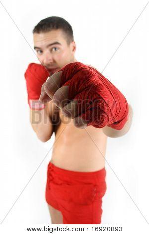 portrait of athletic boxer (fist in focus)