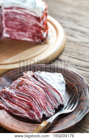 Portion Of Red Velvet Crepe Cake On The Wooden Table
