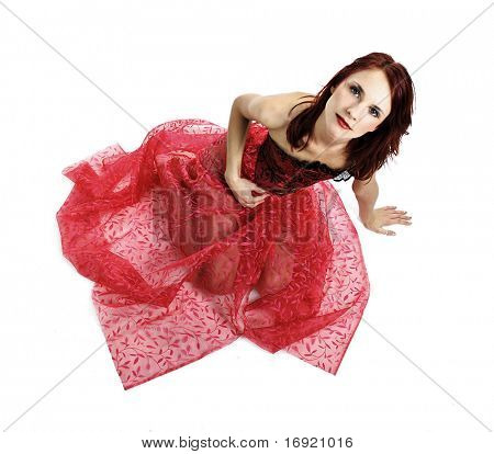 sexy redhead girl in red dress isolated on white background