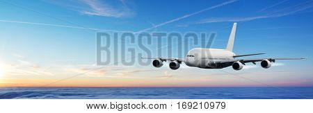 Huge commercial airplane flying above clouds in sunset light. Very high resolution of image