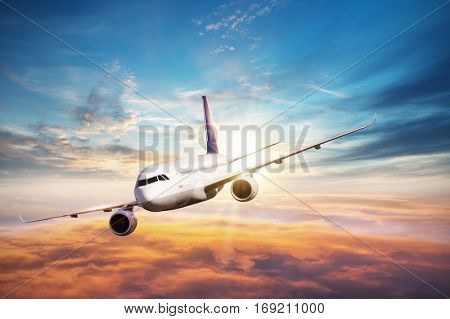 Commercial airplane flying above clouds in dramatic sunset light. Very high resolution of image