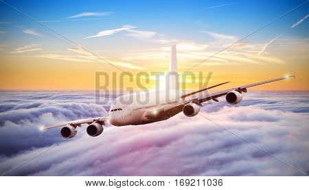 Huge commercial airplane flying above clouds in dramatic sunset light. Very high resolution of image