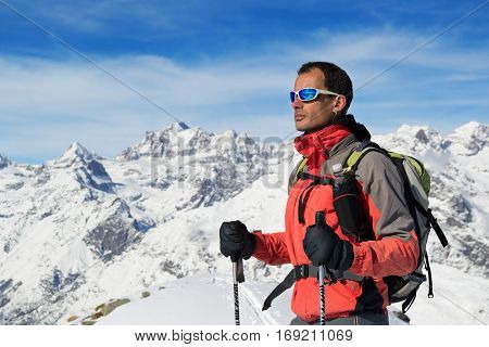 Man mountain winter clothes Ski touring in italian Alps, Gran Paradiso National Park