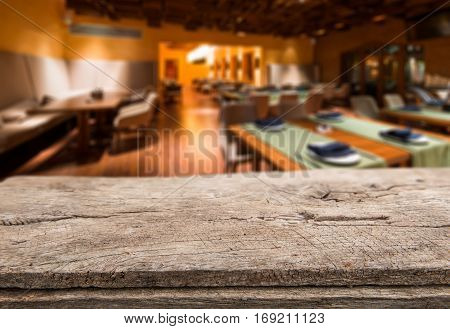 Empty Table Board And Defocused Interior Of Restaurant As Background. Mockup For Display And Montage