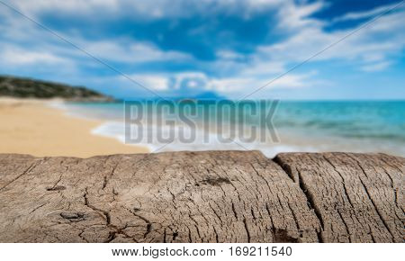 Empty Wooden Table Top And Tropical Beach Scene Background. Mockup For Display Or Montage Products