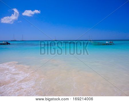 Turquoise turquoise lagoon of a tropical island. Caribbean beautiful place for recuperation relaxation water sports sunbathing and swimming. Warm sea water white sand and the wind.