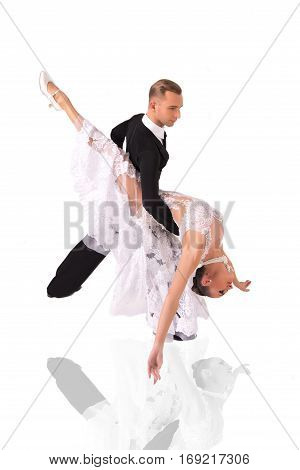 beautiful ballroom dance couple in a dance pose isolated on white background. sensual professional dancers dancing walz tango slowfox and quickstep