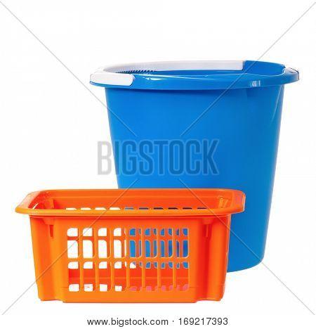 Plastic blue bucket and orange basket, isolated on white background