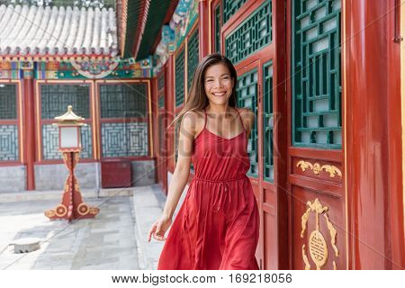 Chinese woman walking at old traditional temple in China - Asia summer travel. Beautiful asian girl tourist happy lifestyle.