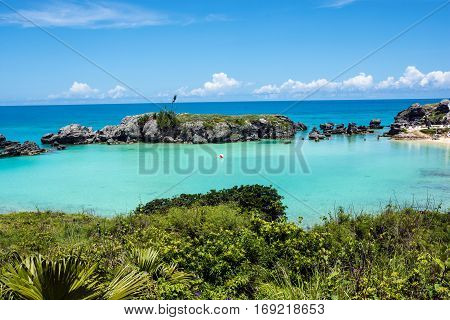 Turquoise colored water of Tobacco Bay a popular beach in Bermuda.
