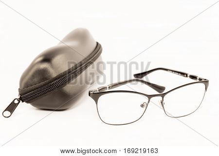 Black eye glasses and case isolated on white background