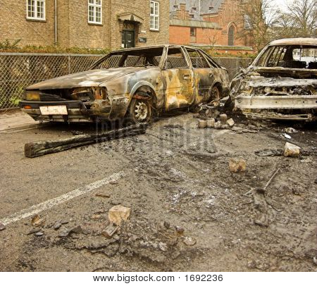 Two Burnt-Out Cars