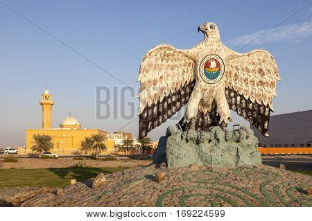 MADINAT ZAYED, UAE - DEC 4, 2016: Falcon monument in a roundabout in the city of Madinat Zayed. Emirate of Abu Dhabi United Arab Emirates