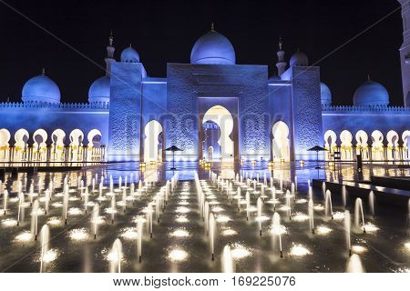 ABU DHABI, UAE - DEC 4, 2016: Sheikh Zayed Grand Mosque illuminated at night. Abu Dhabi United Arab Emirates Middle East