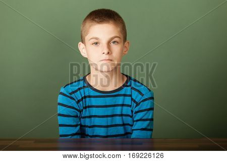 Upset Boy Looking At Camera