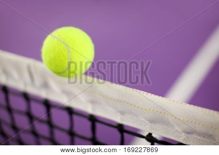 Tennis ball hitting the net