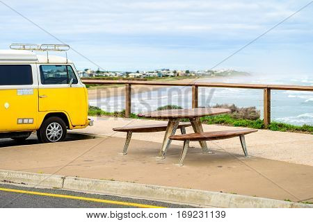 Adelaide Australia - August 14 2016: Picnic table at Middleton Beach with spectacular view into the sea and parked VW minibus